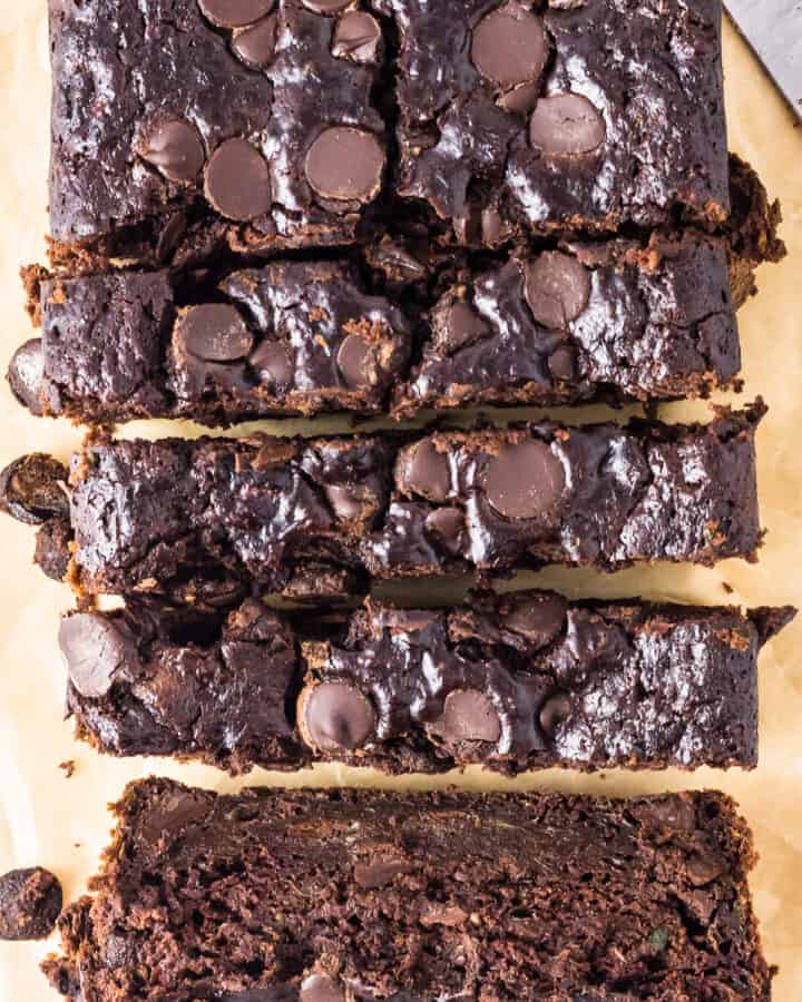 up close overhead sliced chocolate zucchini bread with chocolate chips