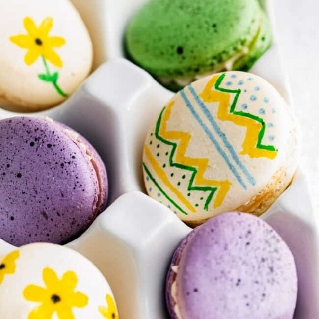 up close painted easter egg macarons in egg crate