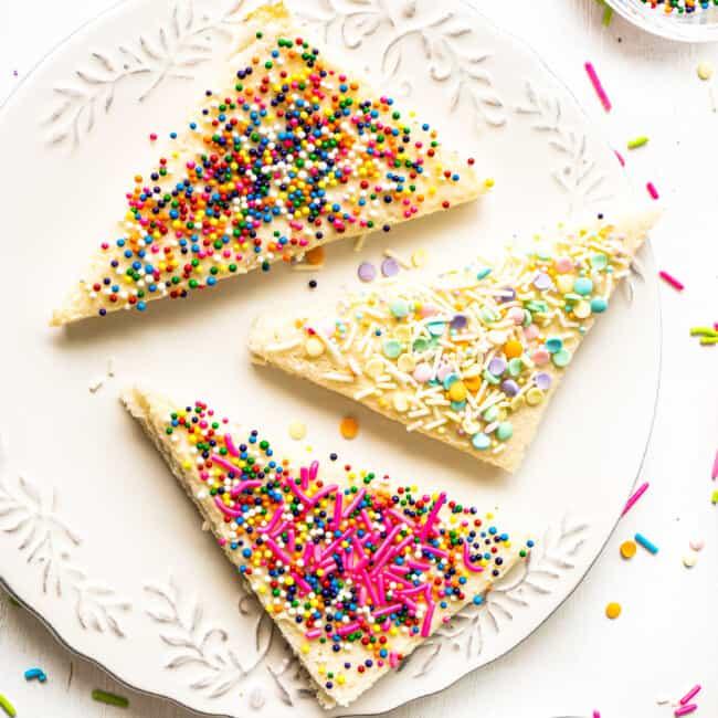 sprinkled fairy bread slices on white plate