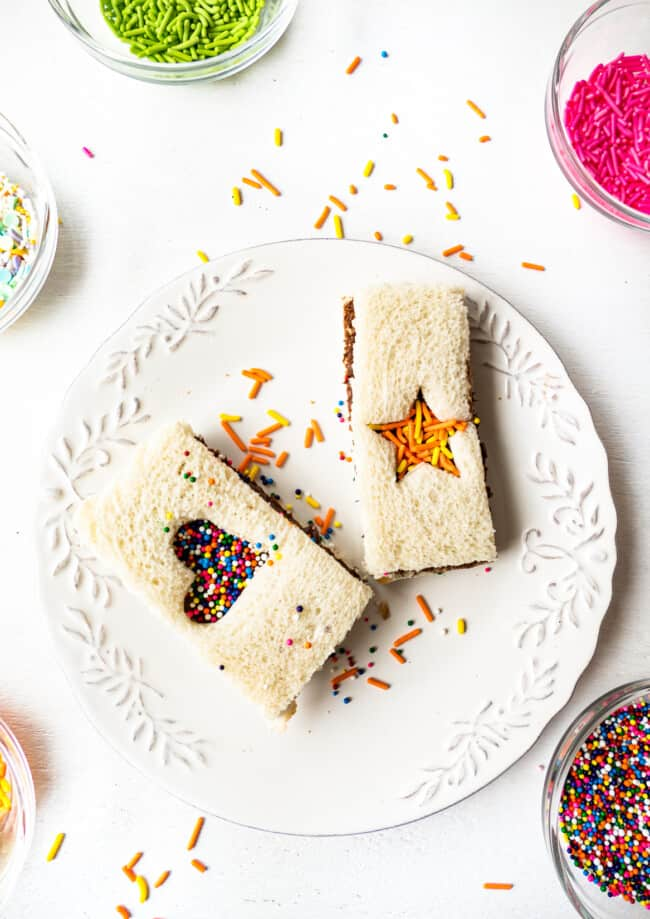 fairy bread with nutella cut outs on white plate