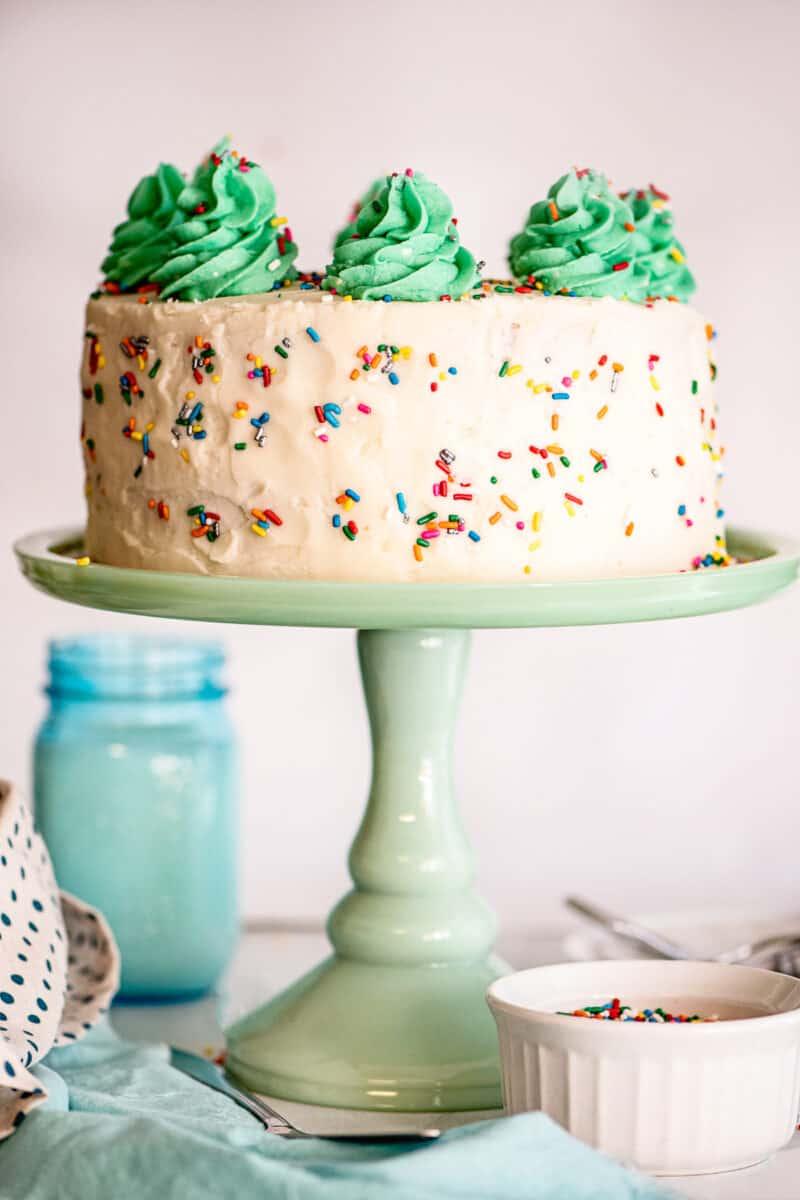 funfetti cake on green cake stand