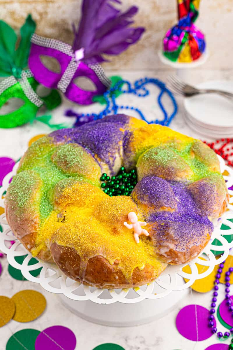 green yellow and purple king cake with baby