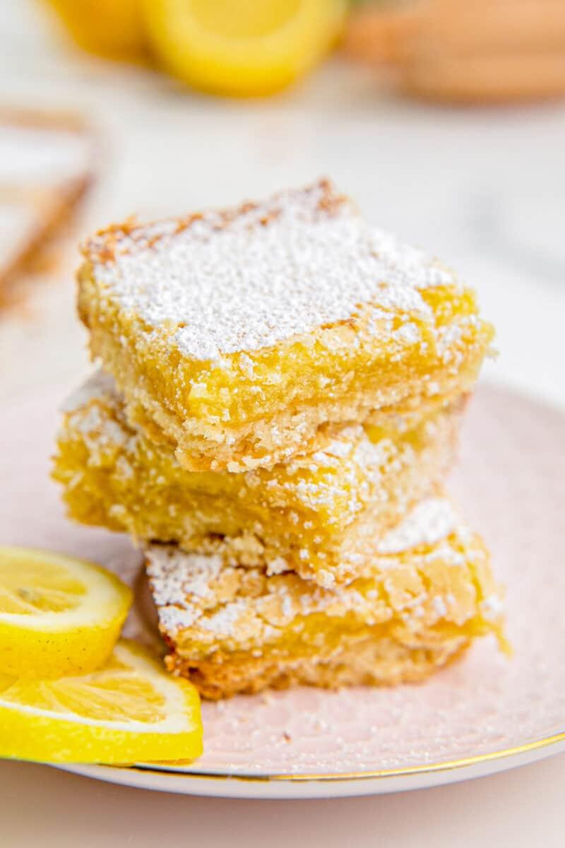 stacked lemon bars with powdered sugar