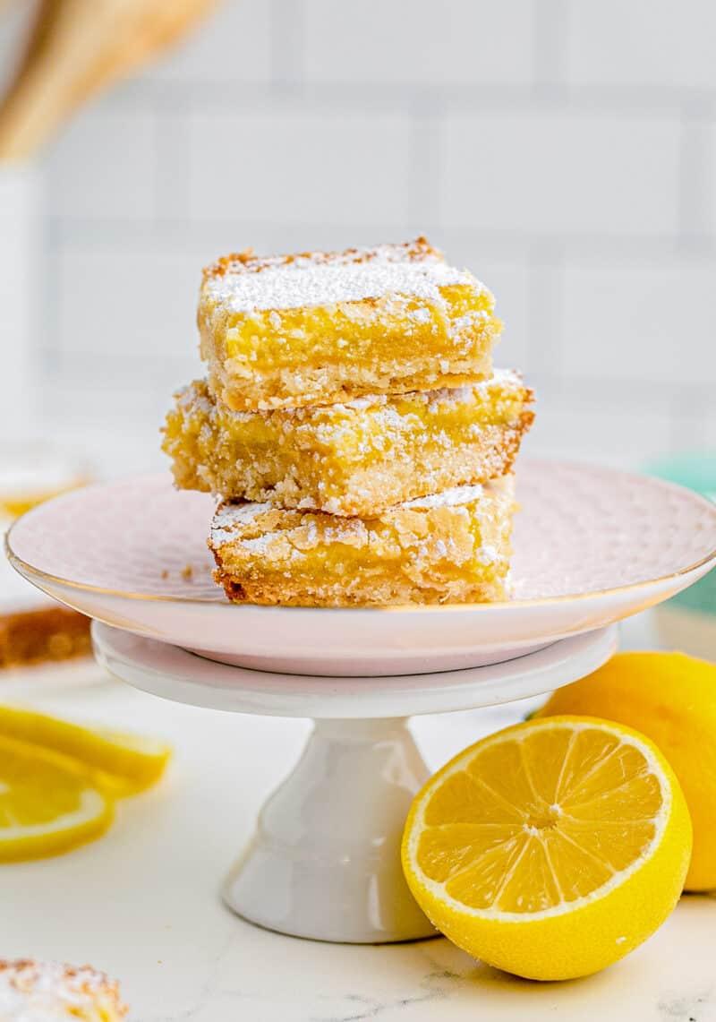 stacked lemon bars on cake stand