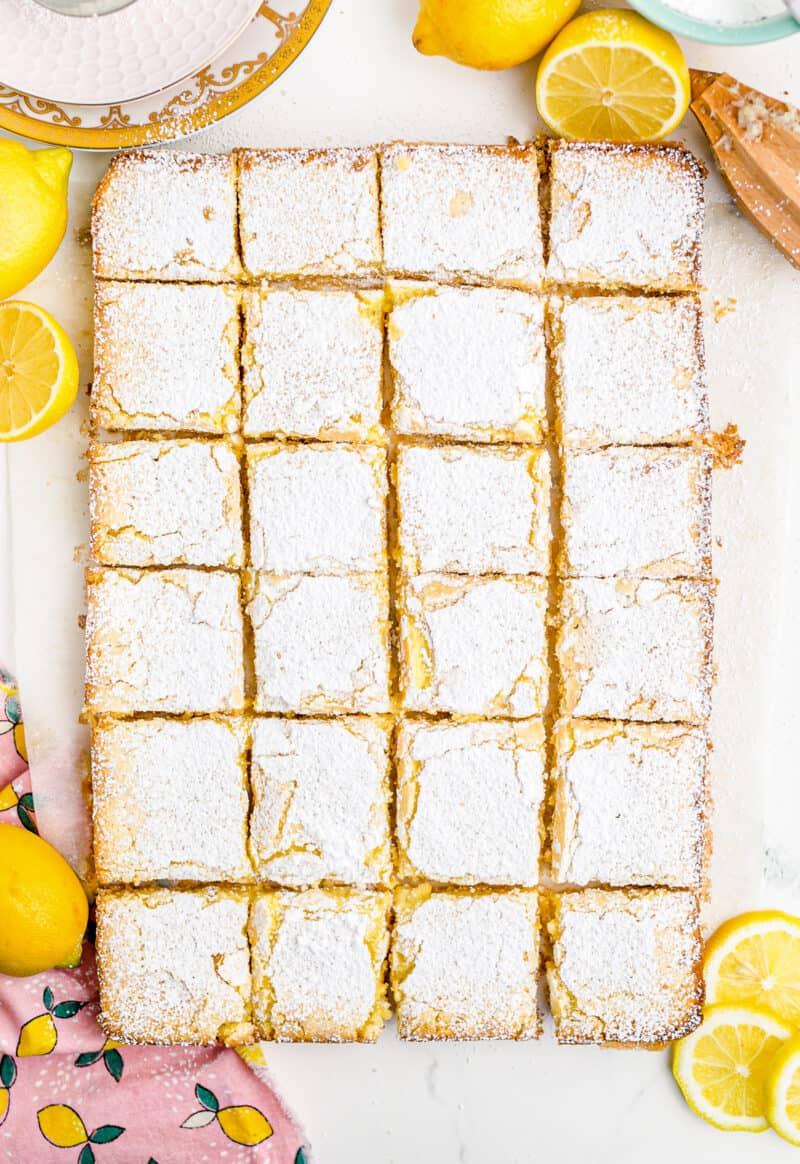 overhead image of sliced lemon bars sprinkled with powdered sugar