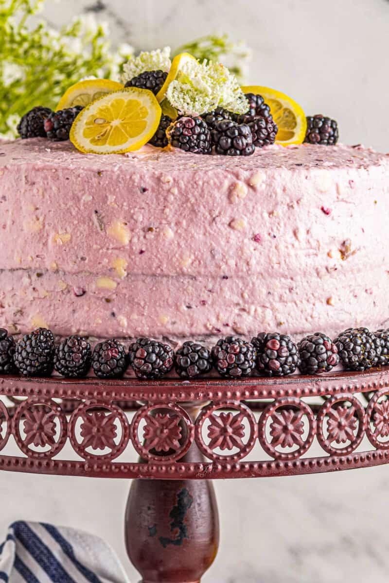 lemon blackberry cake on cake stand
