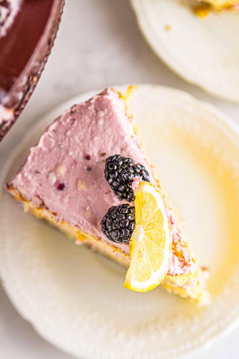 overhead slice of lemon blackberry cake