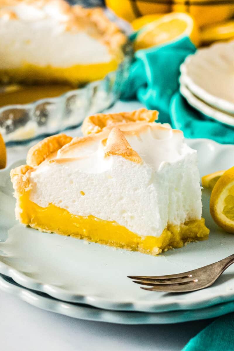 slice of lemon meringue pie on plate