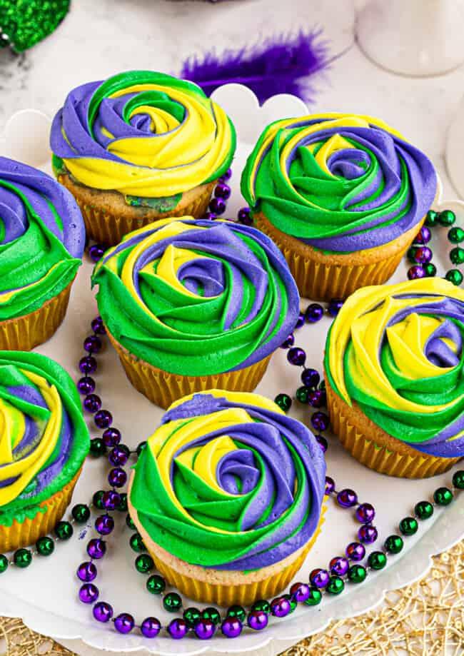 purple yellow and green king cake mardi gras cupcakes on platter