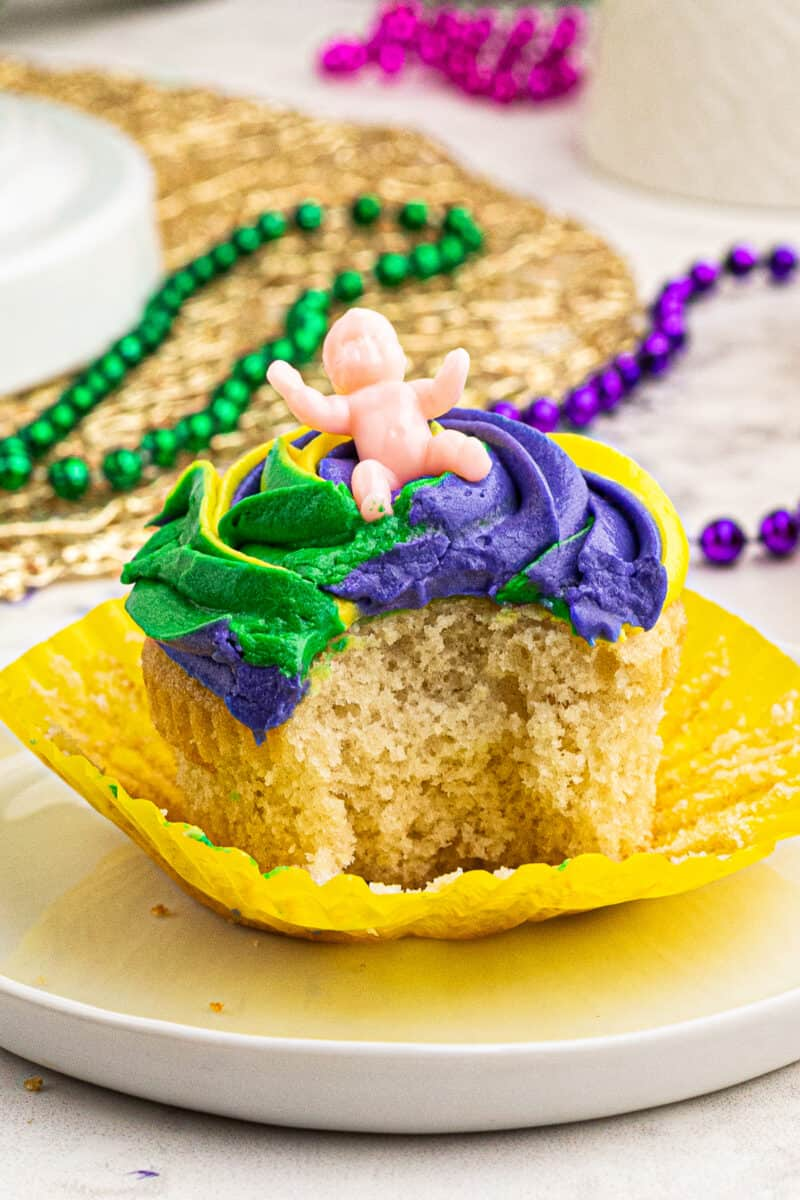 bite out of mardi gras cupcake with baby