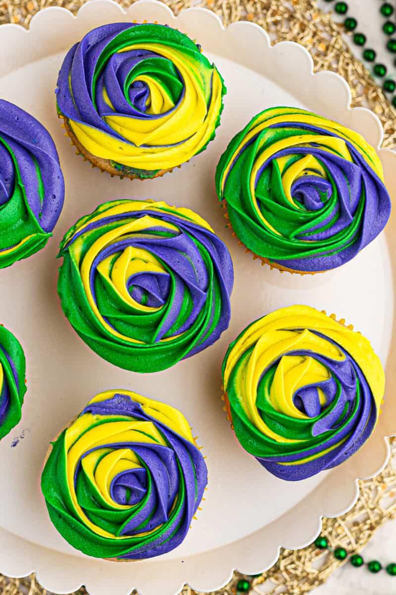 overhead image of decorated mardi gras cupcakes