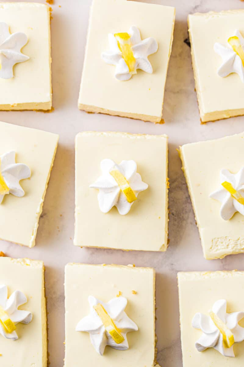 overhead slices of no bake lemon cheesecake garnished with whipped cream