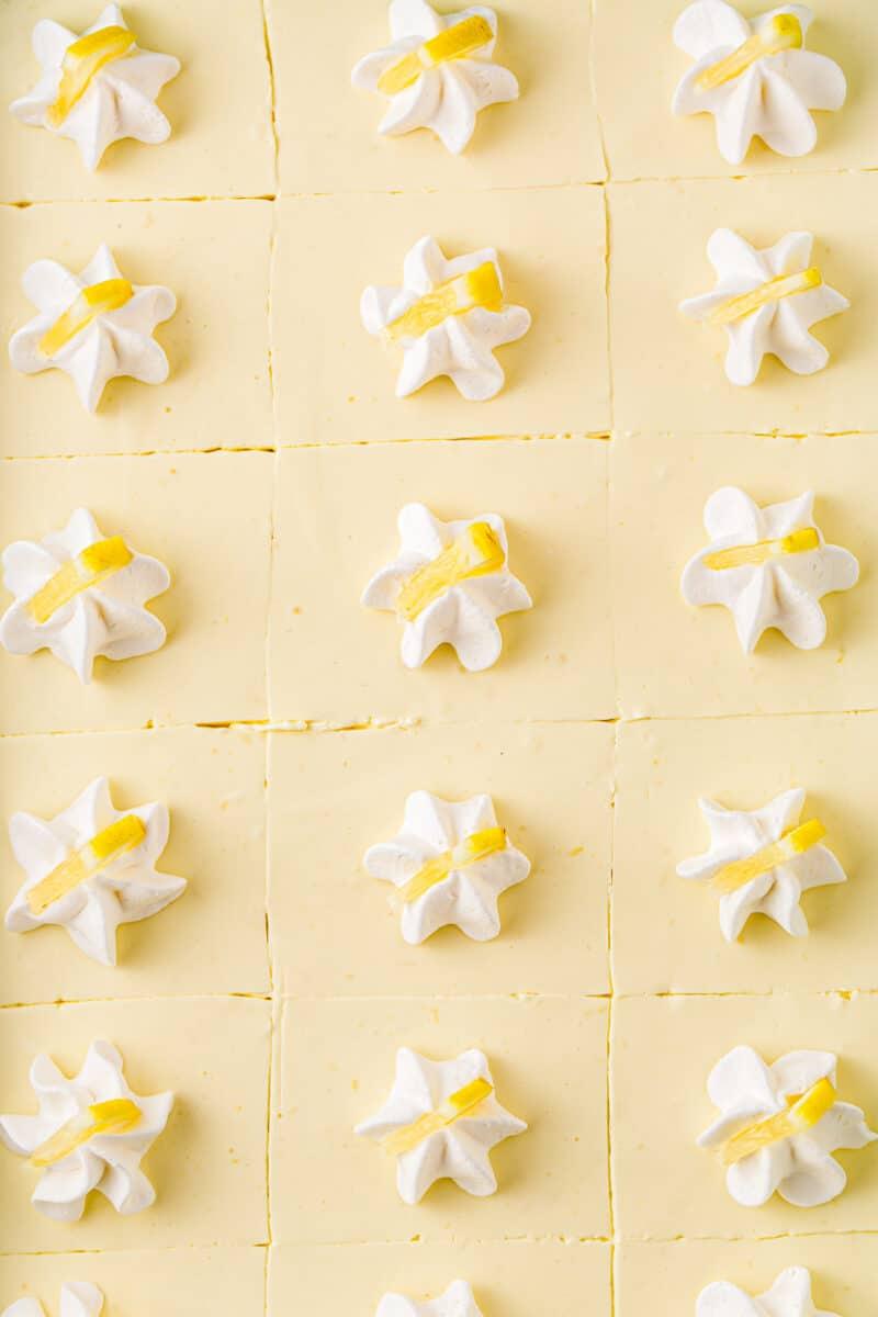 up close sliced no bake lemon cheesecake with whipped cream garnish