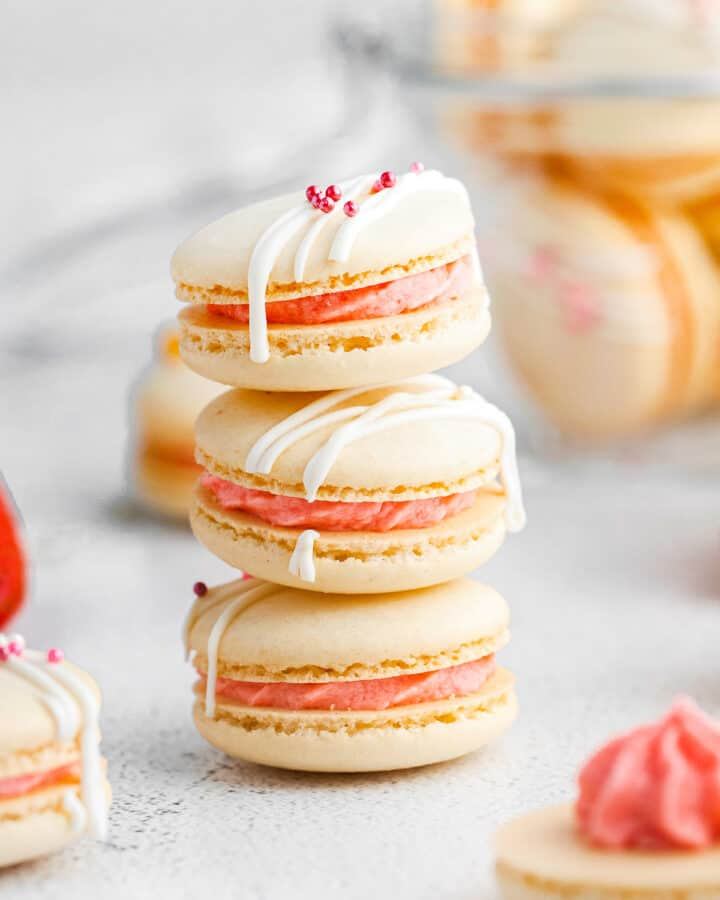 stacked strawberry macarons on white table