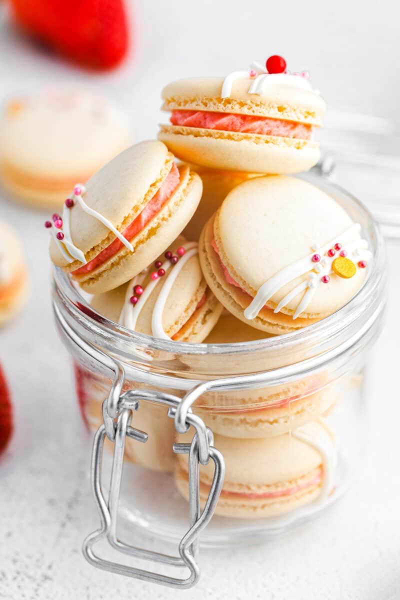 clear glass jar of strawberry macaron cookies