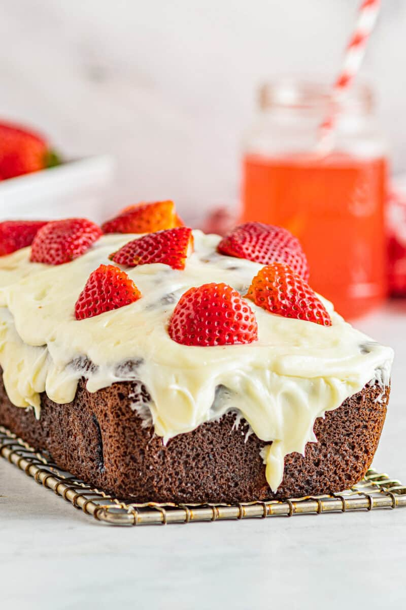 iced strawberry pound cake on cooling rack