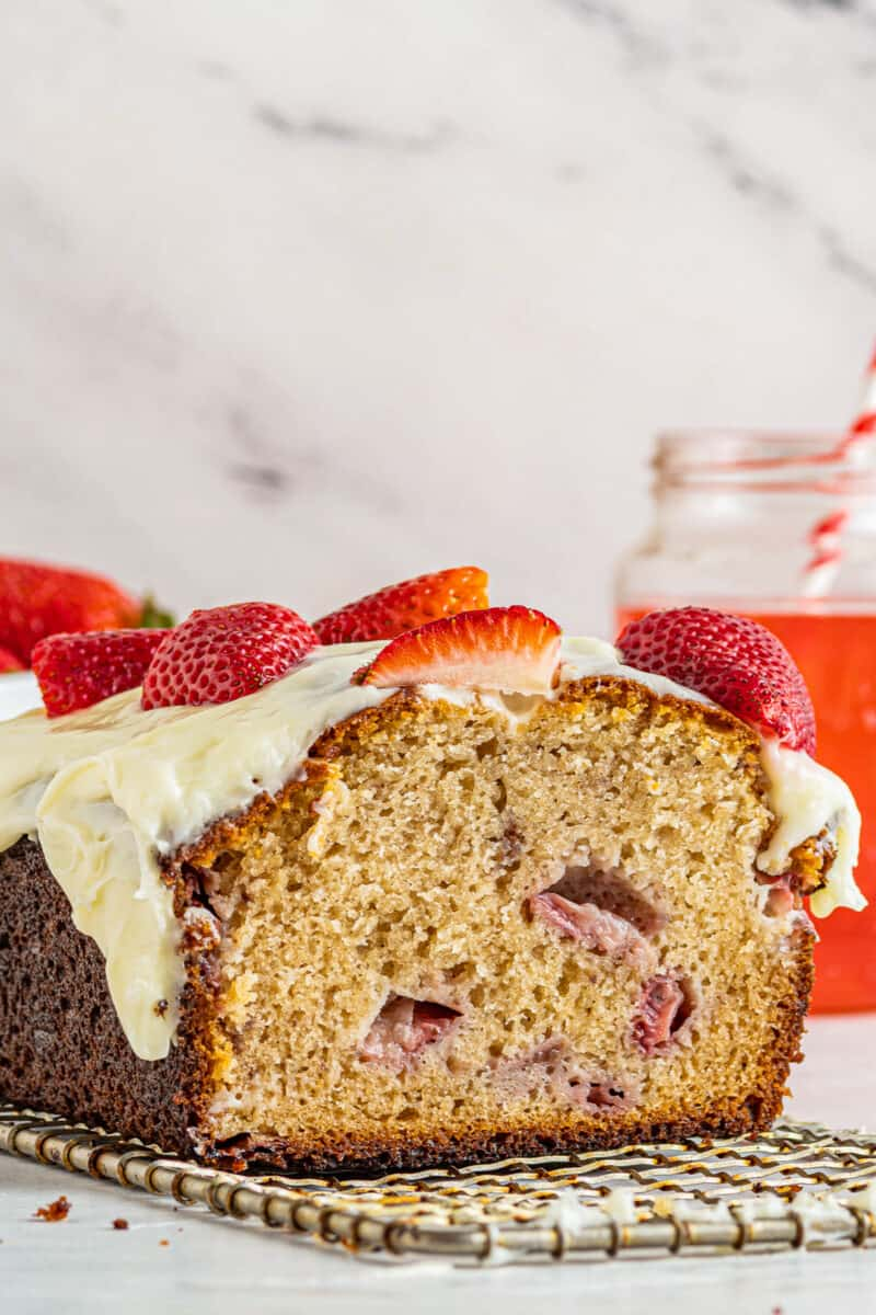 sliced strawberry pound cake with frosting