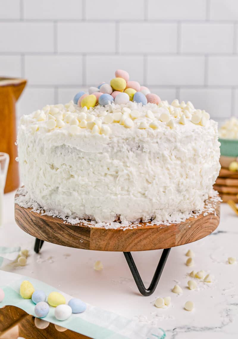 white chocolate coconut easter cake garnished with mini eggs