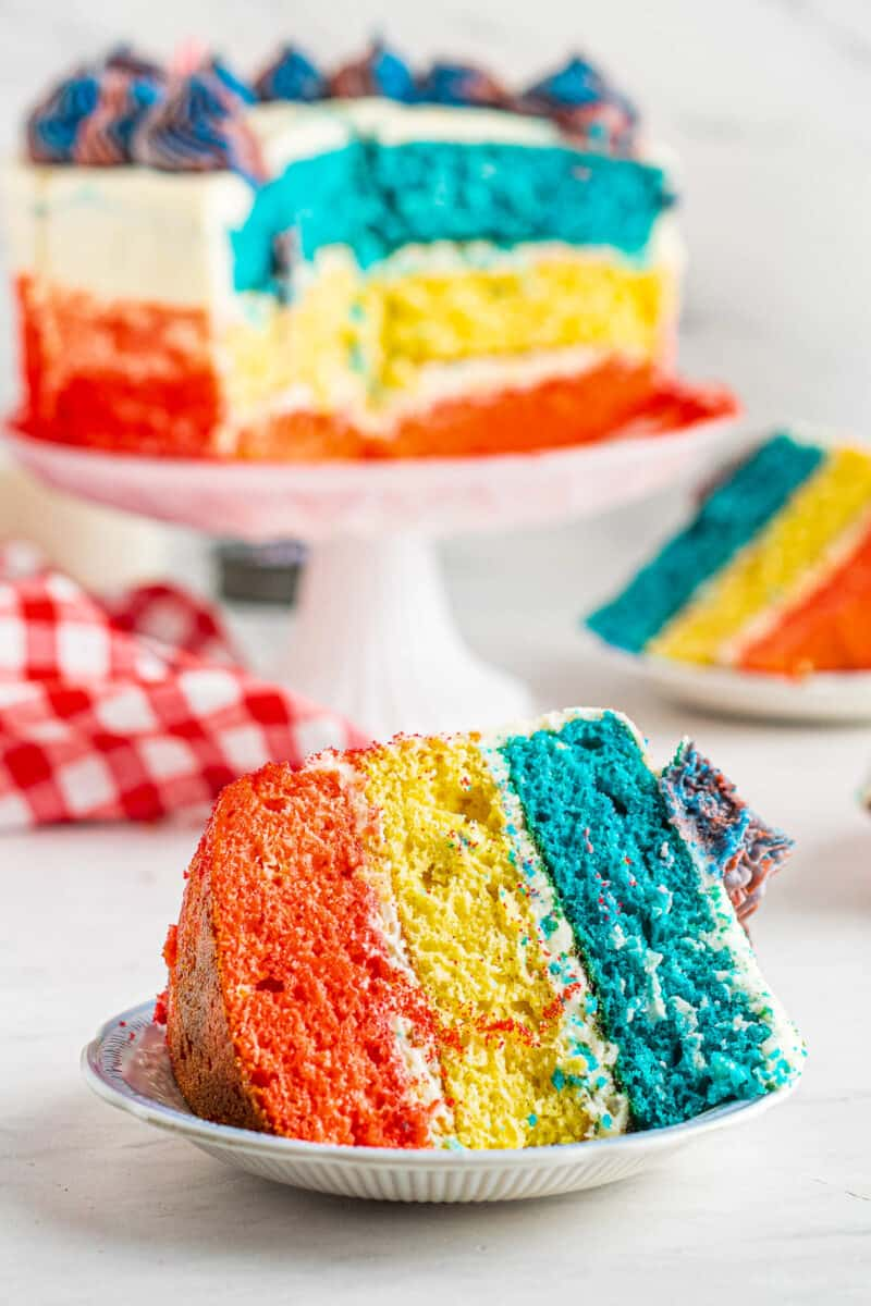 slice of red white and blue layer cake