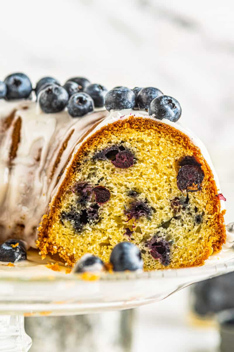up close inside of blueberry bundt cake with glaze and blueberries