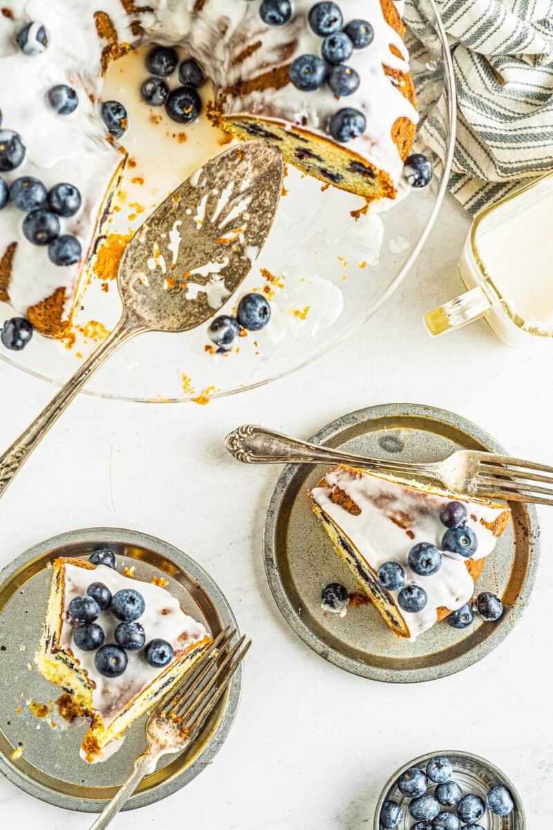 slices of blueberry bundt cake on gray plates