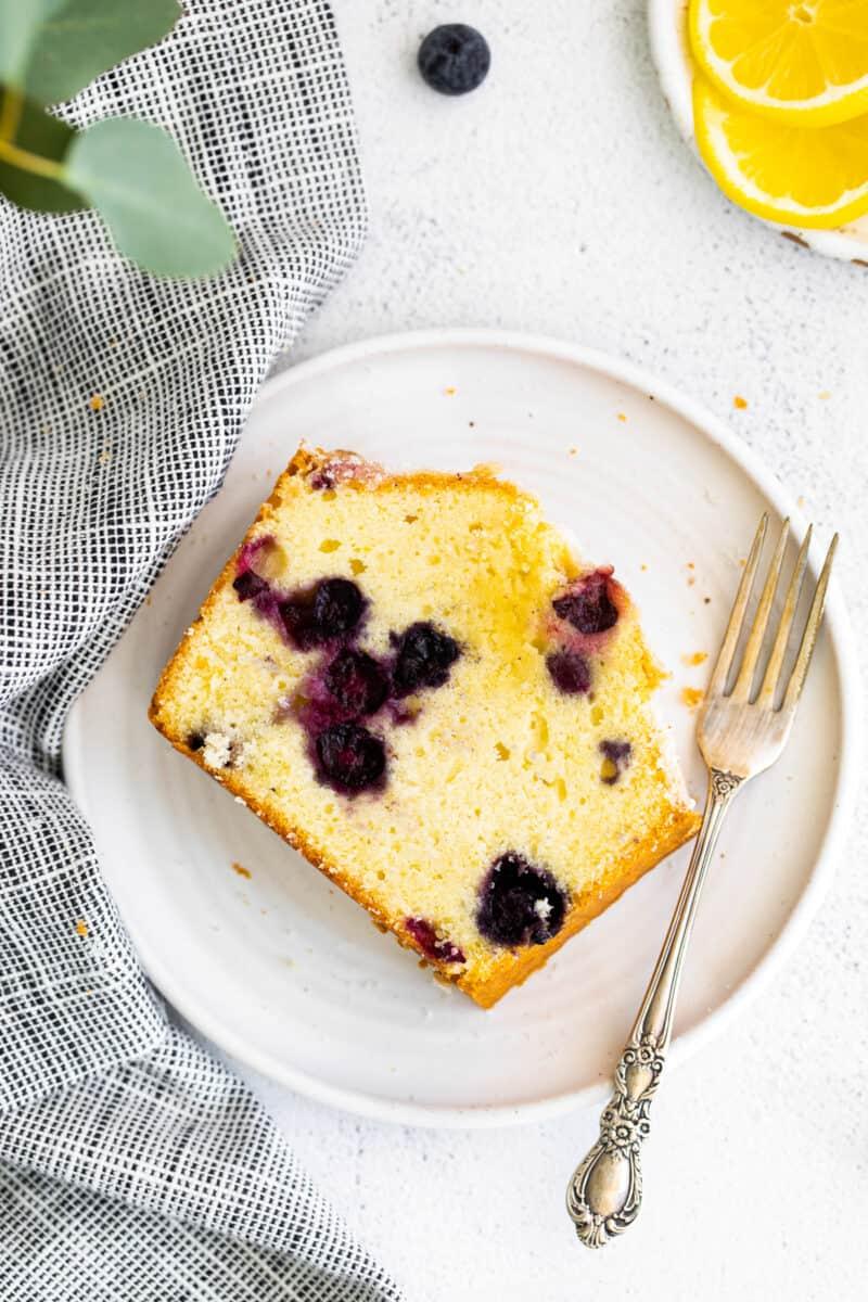 slice of blueberry lemon pound cake on white plate