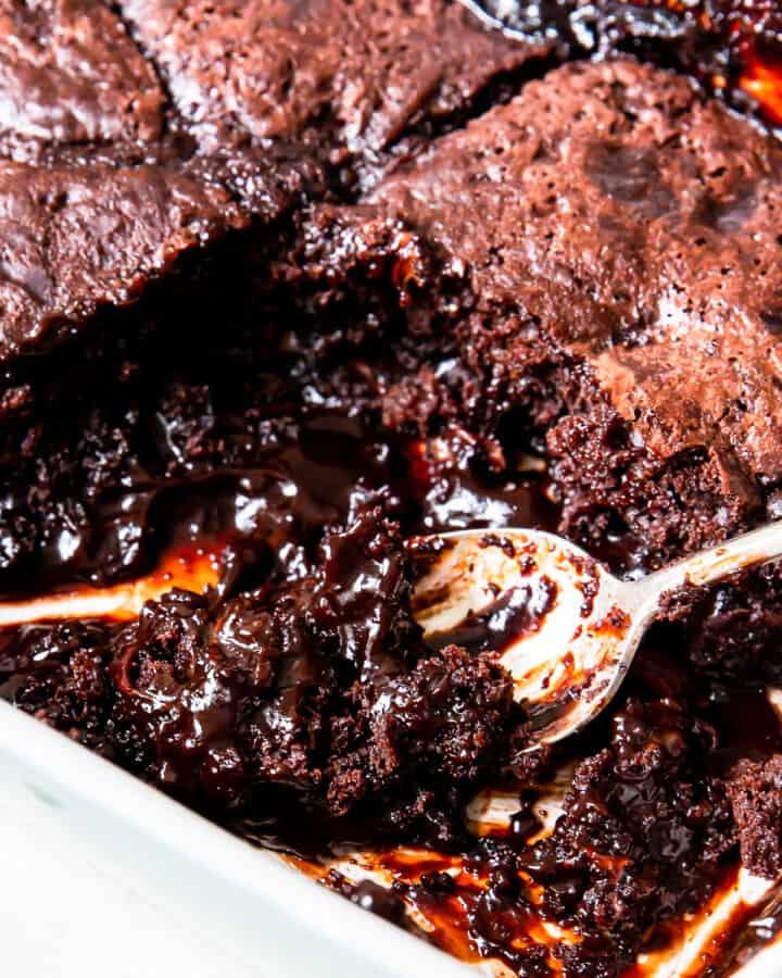 spoon in pan of chocolate cobbler