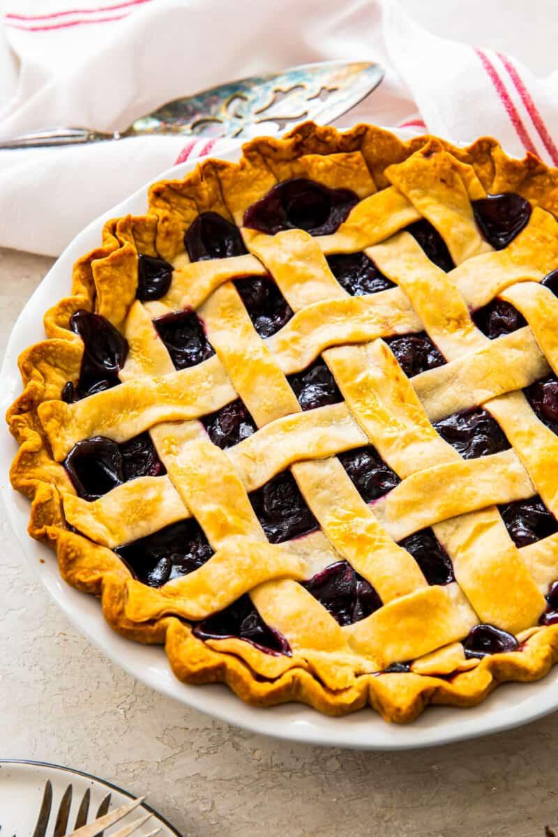 full lattice cherry pie in pie tin