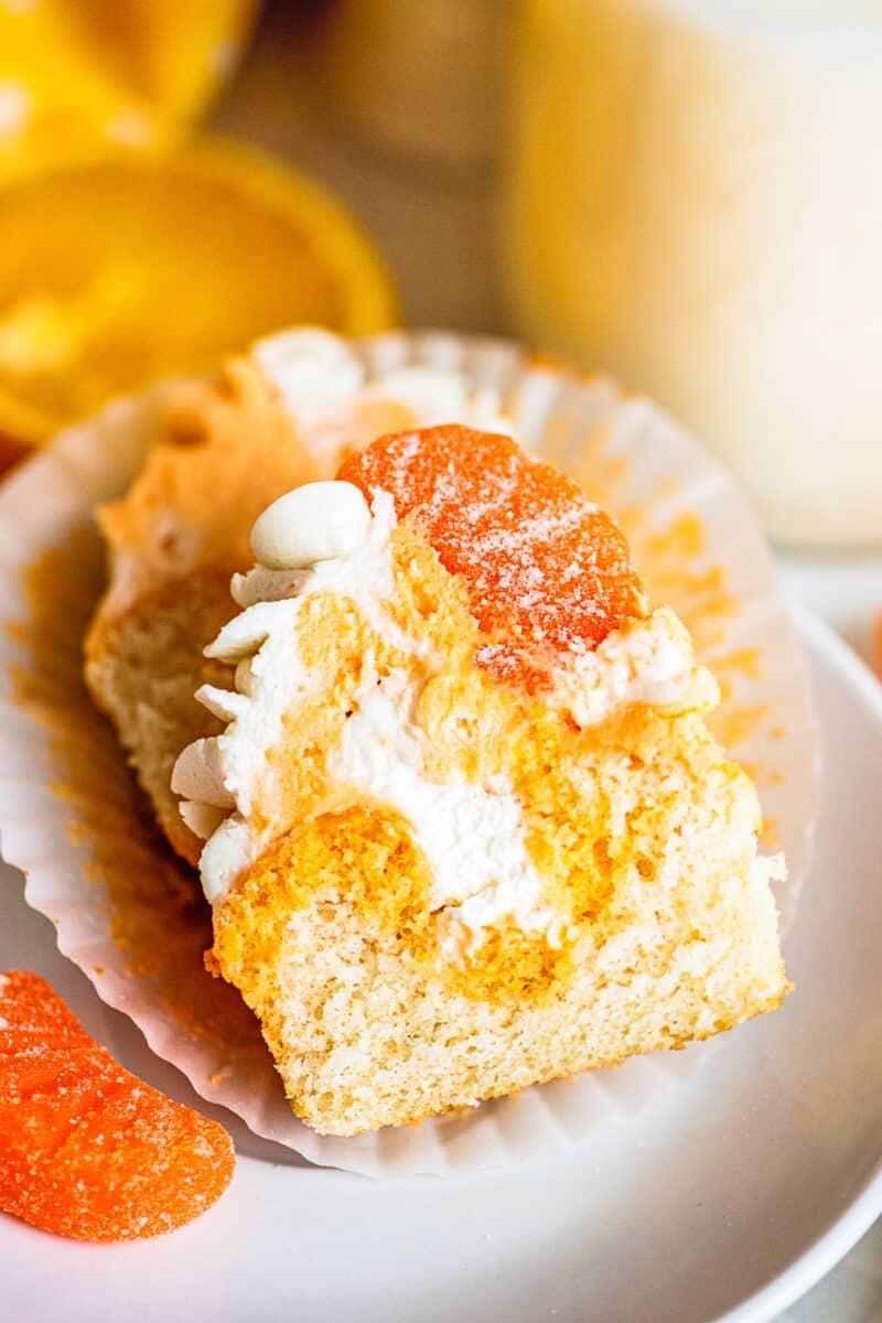 stuffed orange creamsicle cupcake cut in half