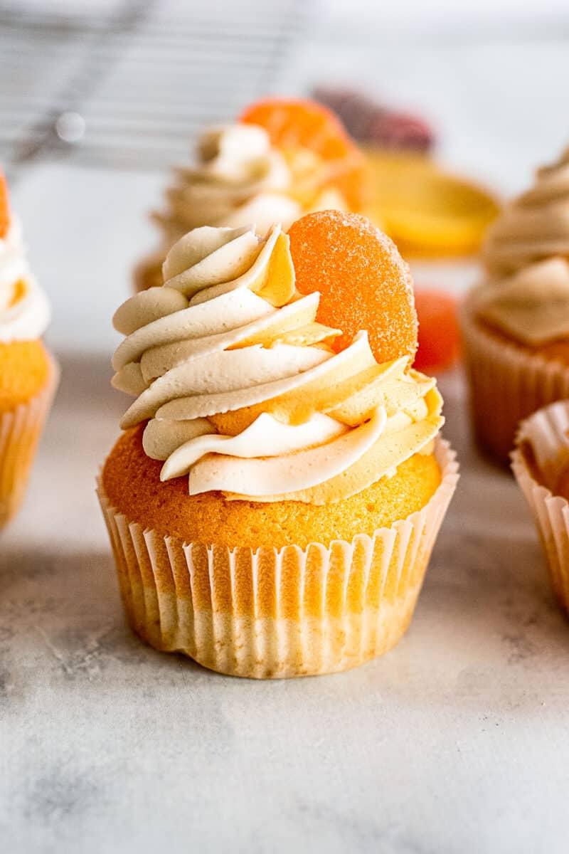 orange creamsicle cupcakes on table