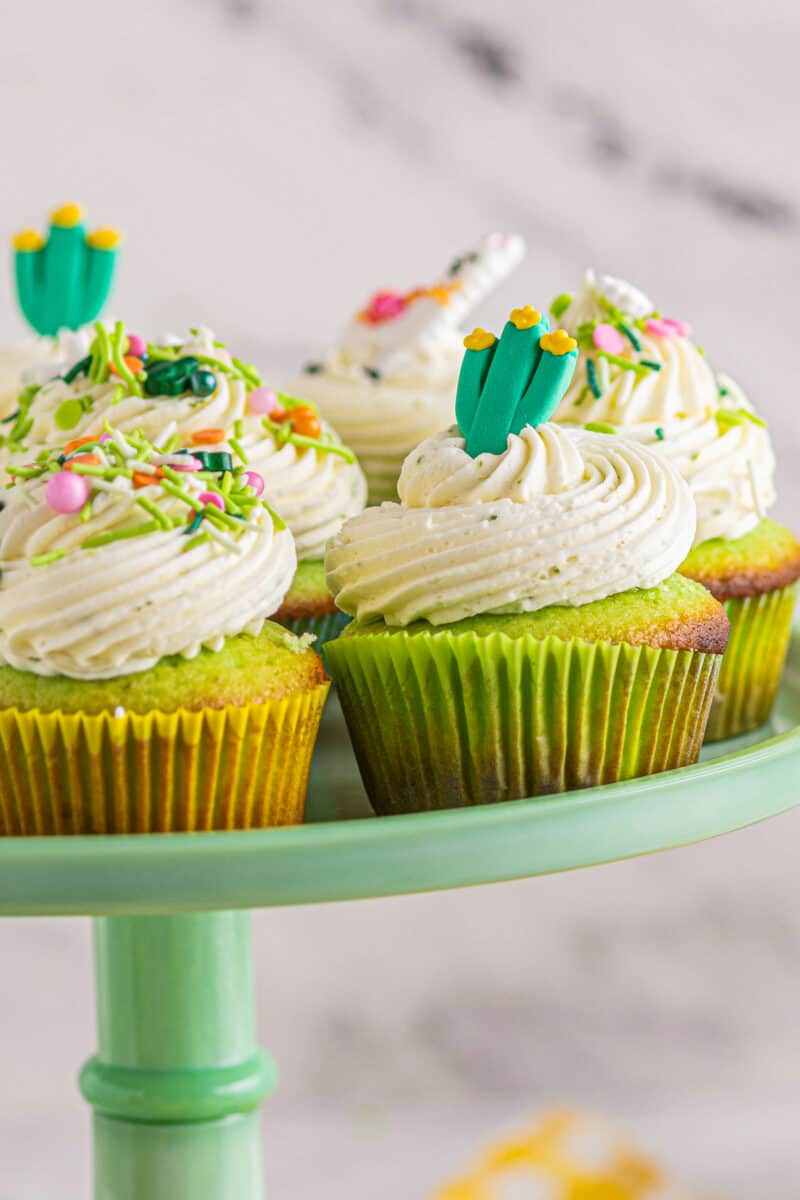 cake stand with pinata cinco de mayo cupcakes with lime buttercream
