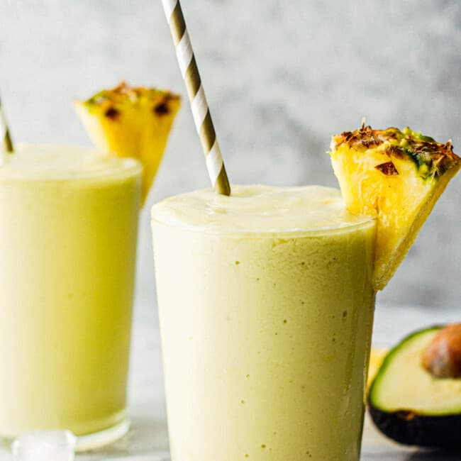 pineapple avocado smoothie recipe garnished with fresh pineapple