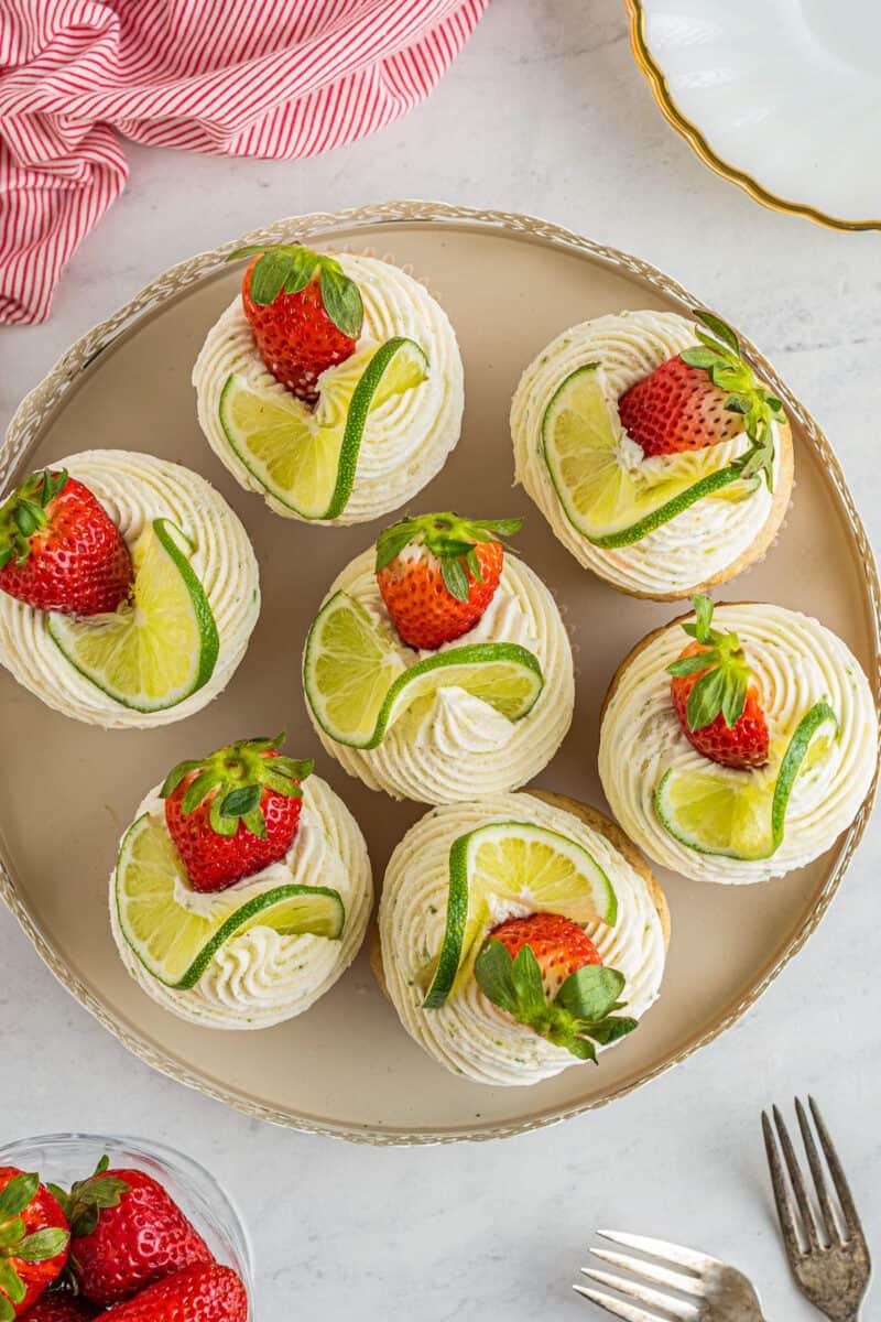 overhead photos of strawberry margarita cupcakes on platter