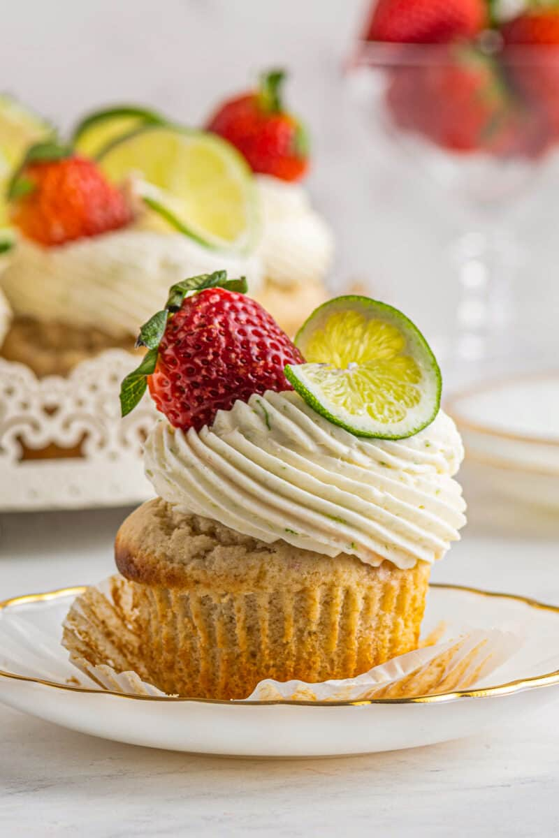 strawberry margarita cupcakes garnished with strawberry and lime