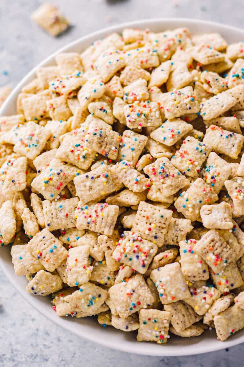 cake batter puppy chow in white bowl