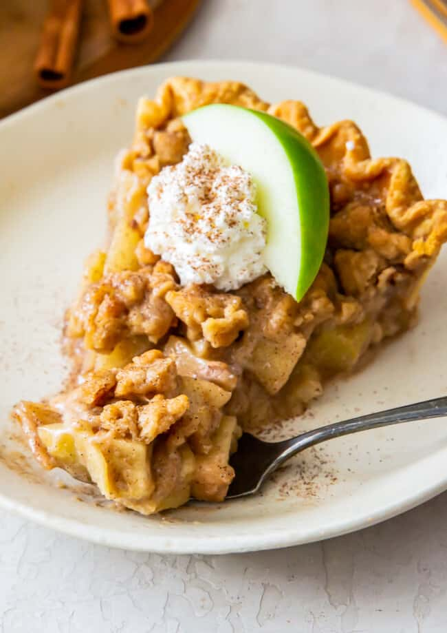 slice of dutch apple pie with whipped cream