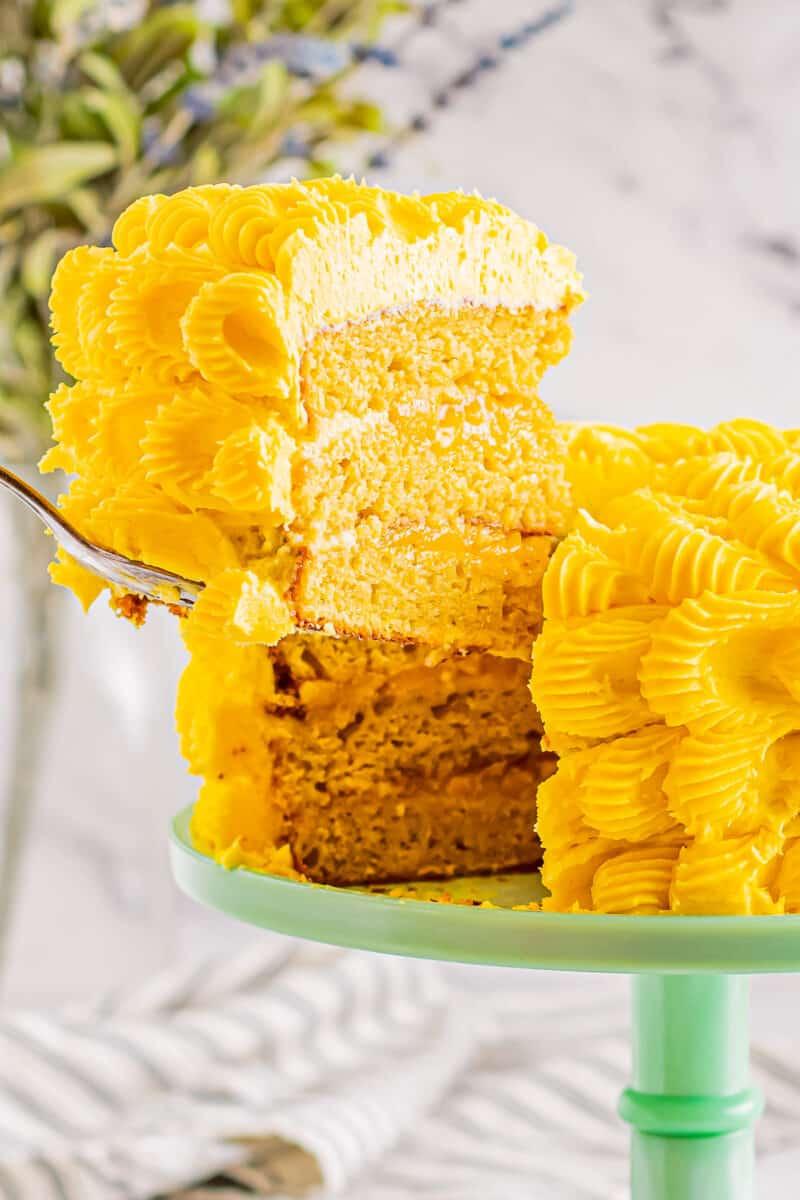 slice out of layered mango cake
