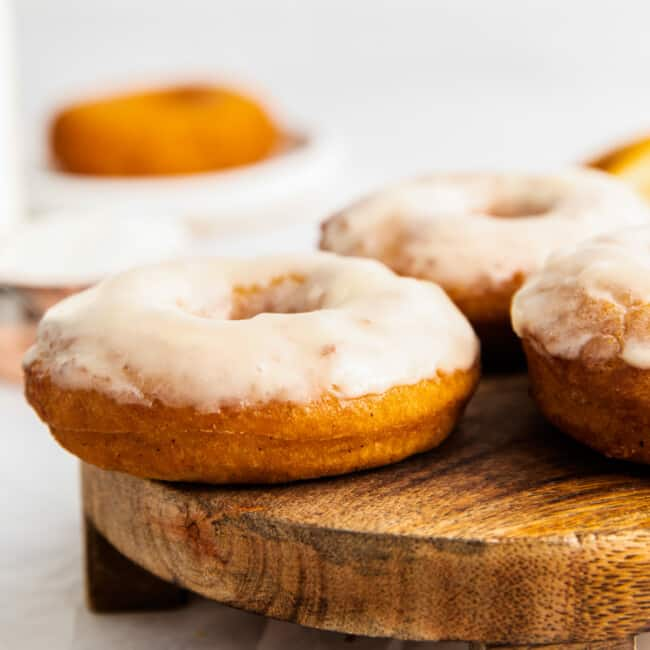 3 old fashioned glazed donuts on serving tray