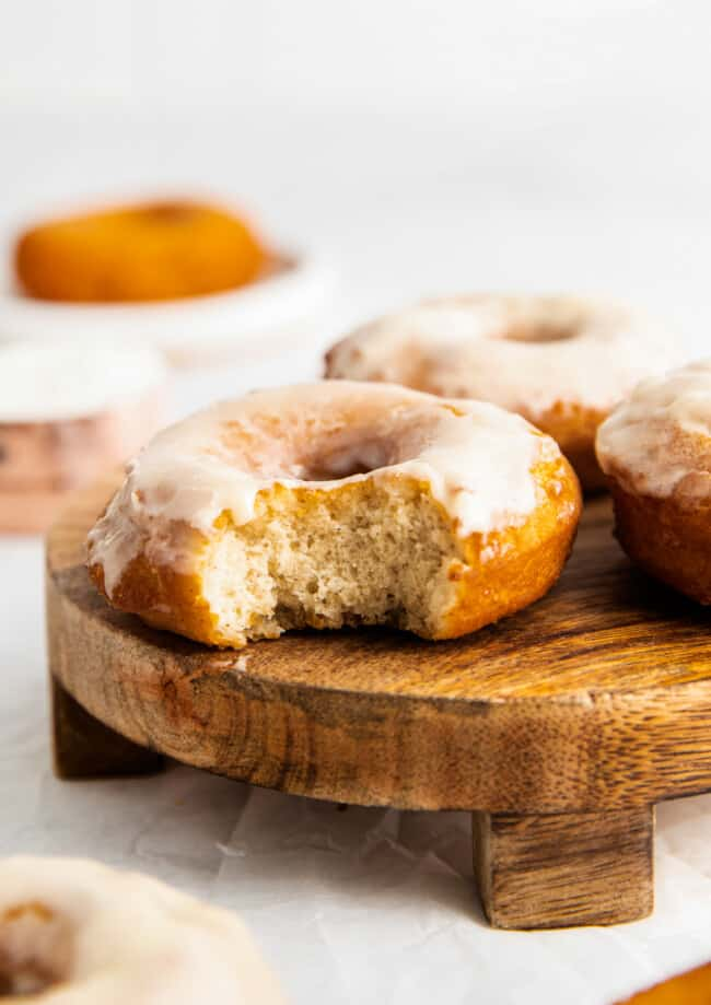bite out of glazed donuts