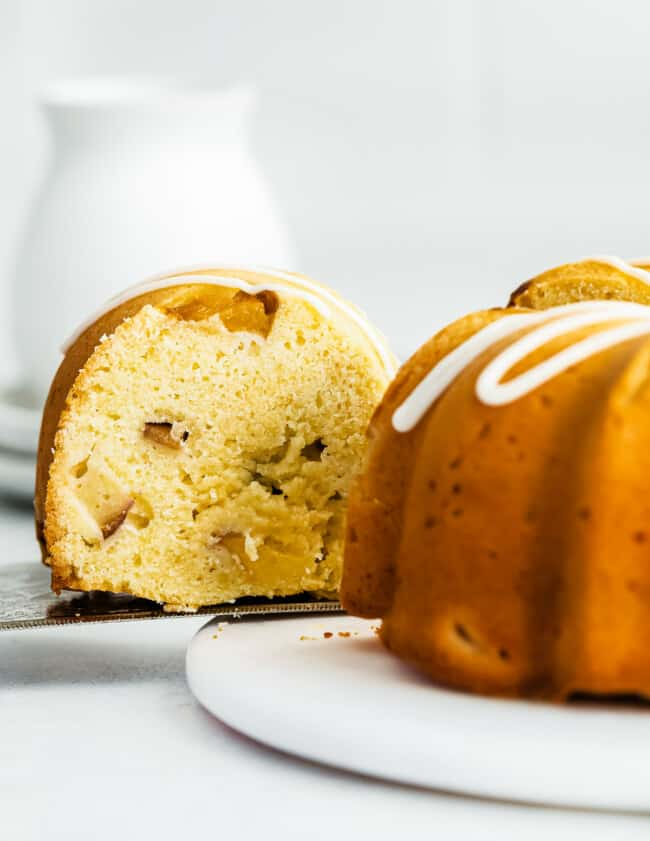 side image of slice being taken out of peach bundt cake