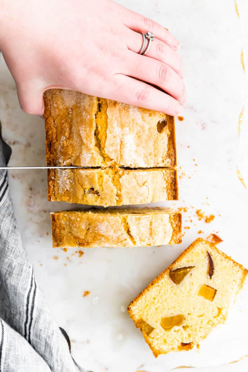 slicing fresh peach pound cake
