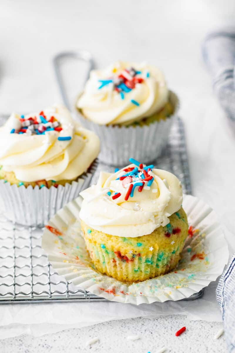 3 fourth of july cupcakes with frosting and sprinkles