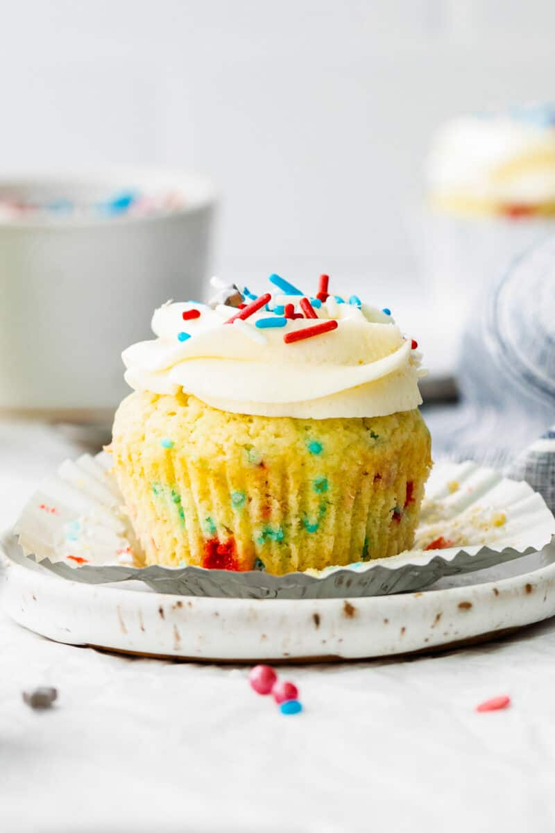 fourth of july cupcake with frosting and sprinkles