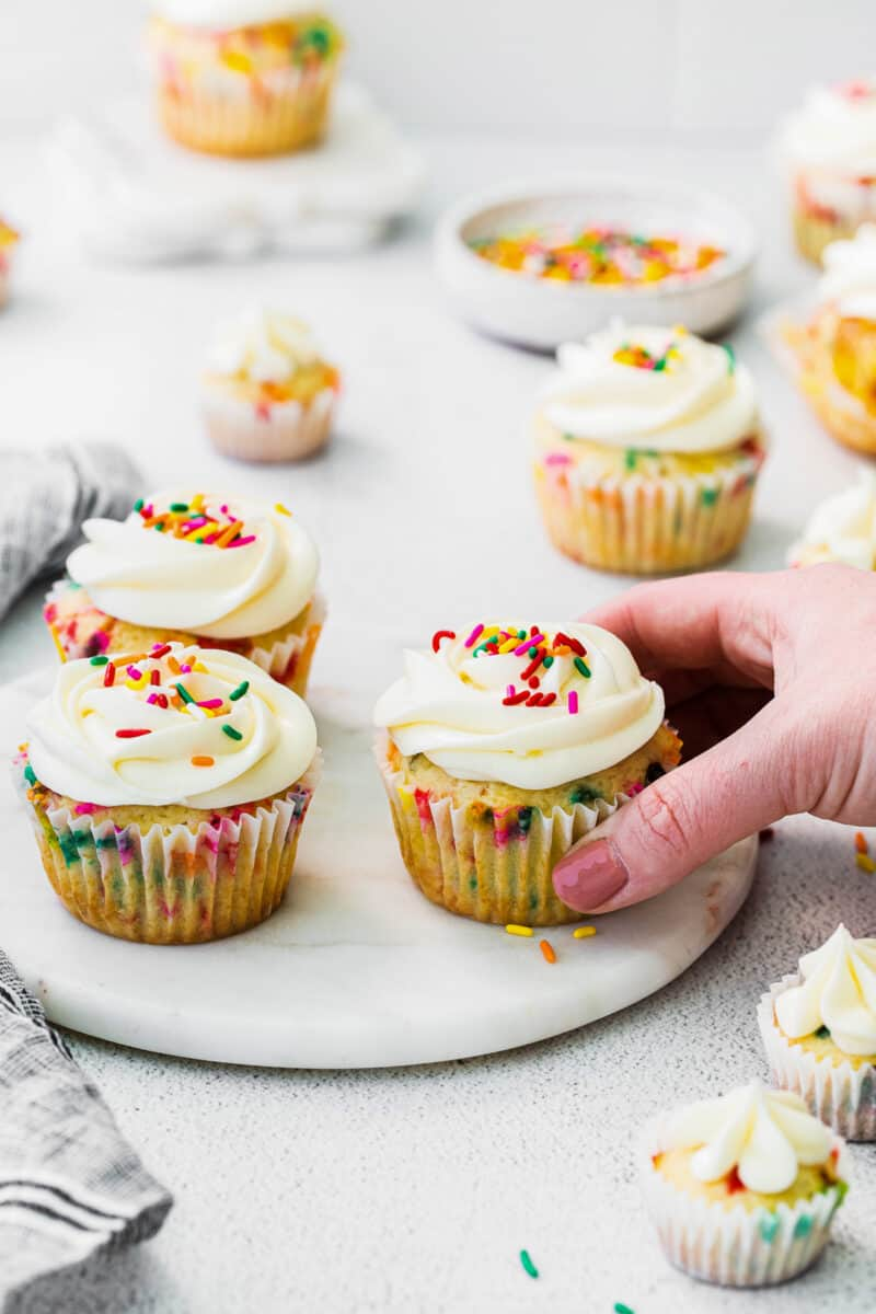 frosted funfetti cupcakes with sprinkles