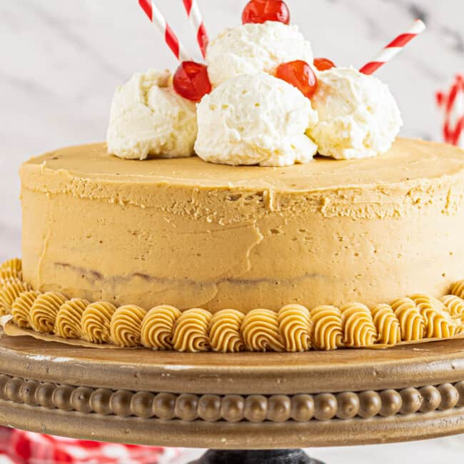 up close root beer float layer cake on cake stand