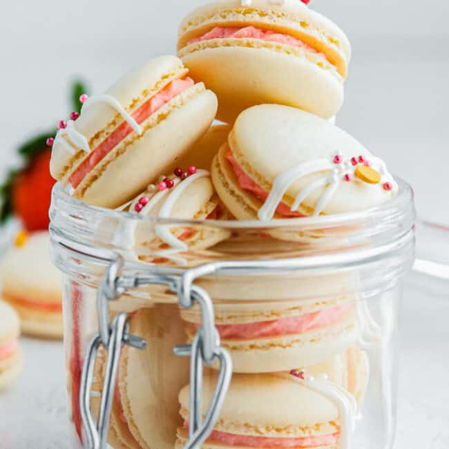 up close strawberry macarons in jar