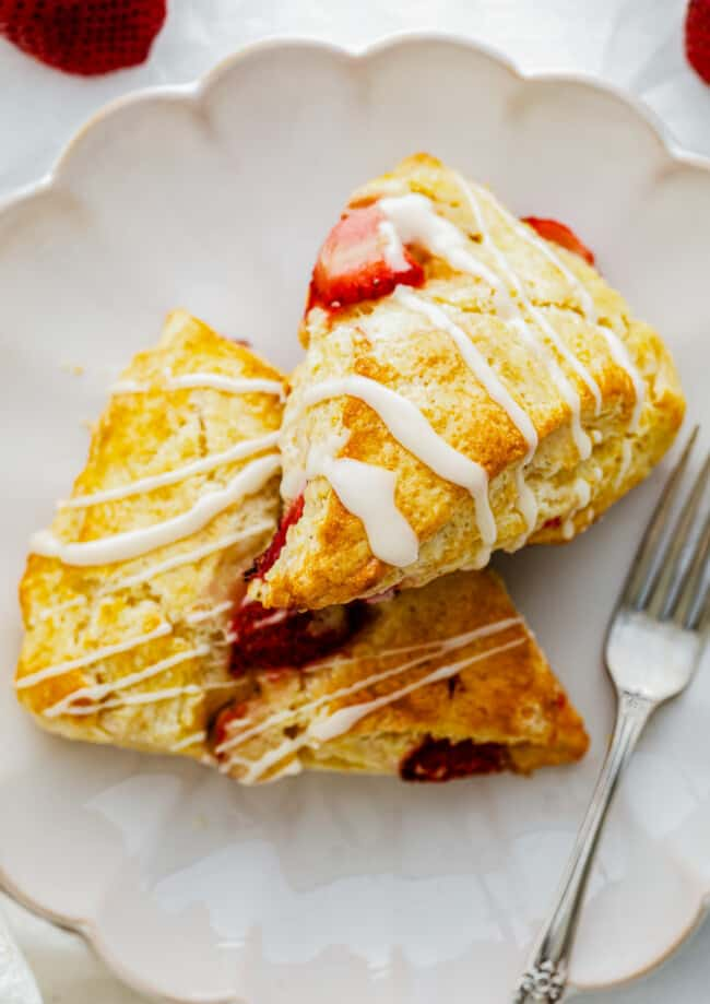 fresh strawberry scones on white plate