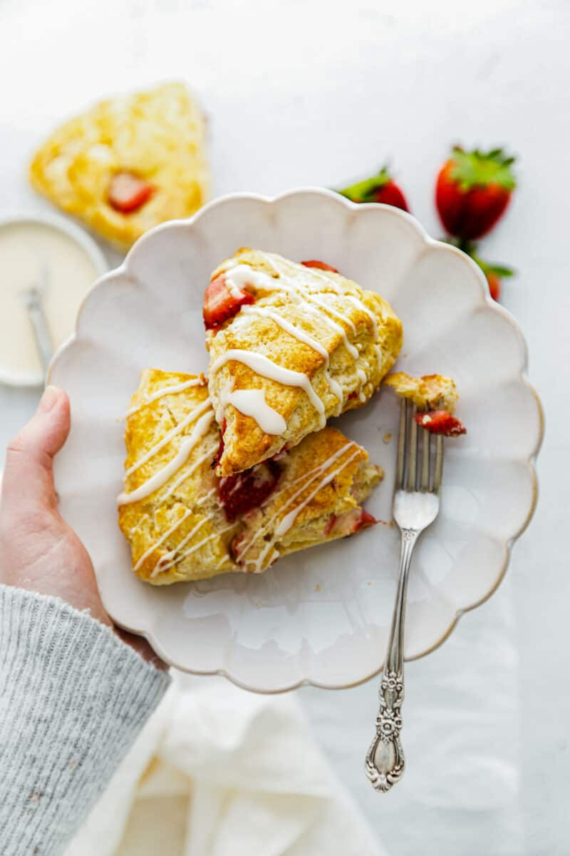strawberry scones drizzled with glaze on plate
