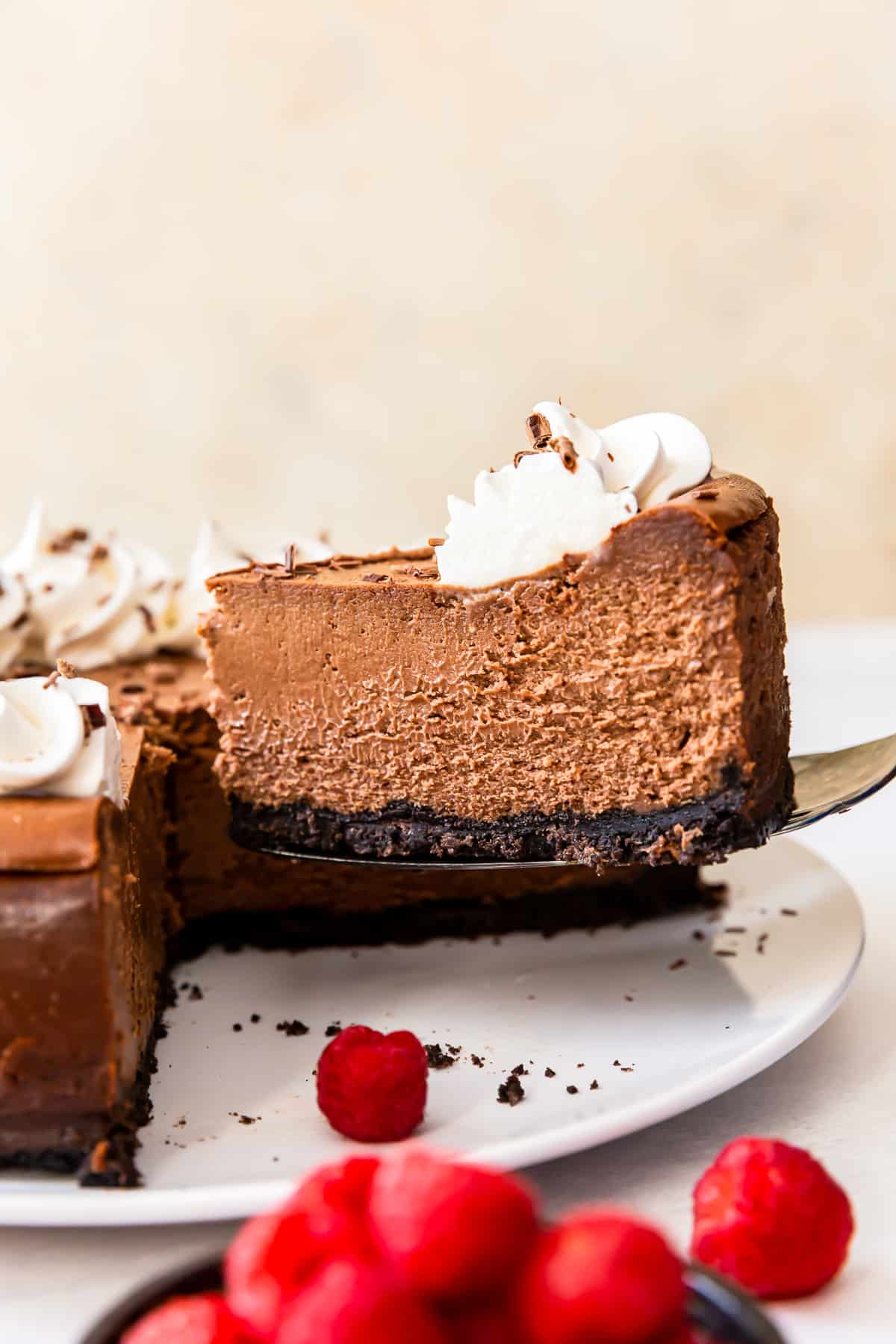 slice of chocolate cheesecake being lifted up