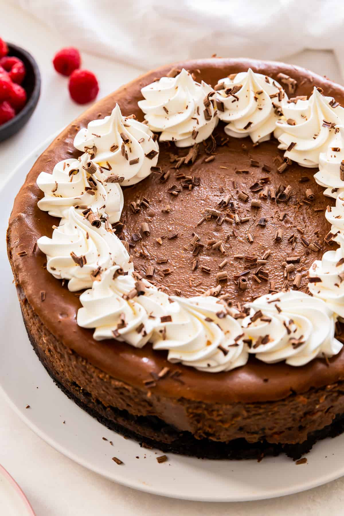 chocolate cheesecake with whipped cream